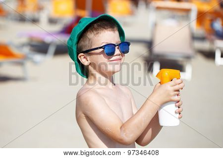 Kid Applying Sunscreen Spray