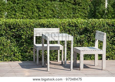 Empty Wooden Table And Chairs Of A Tropical Garden