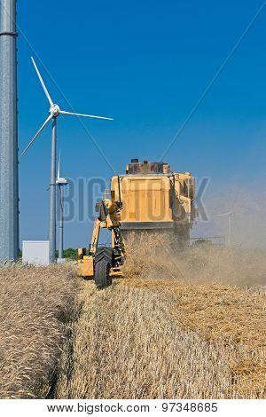 harvester with wind turbine