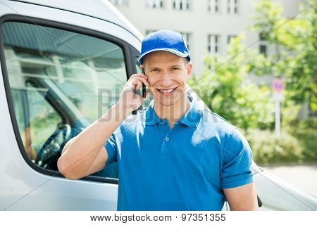 Worker In Front Truck Talking On Mobile Phone