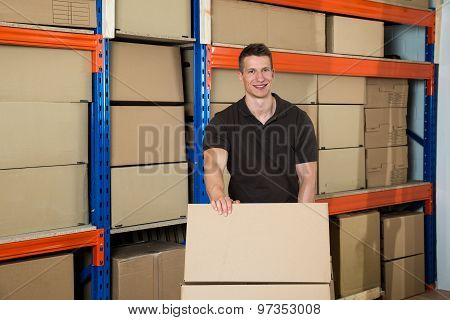 Worker With Boxes In Warehouse