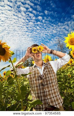 Funny Man In Checkered Vest With The Sunflower Binocular