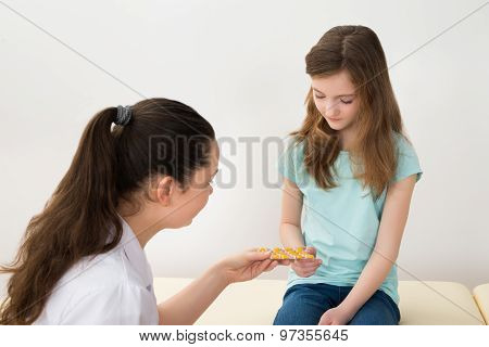 Doctor Giving Medicines To Patient