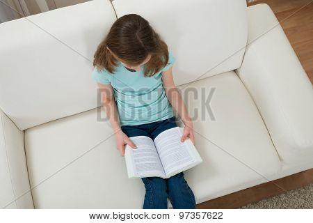 Girl On Sofa Reading Book