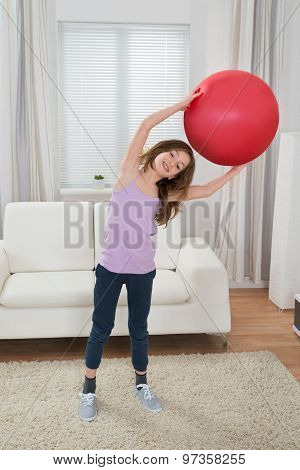Girl Holding Fitness Ball