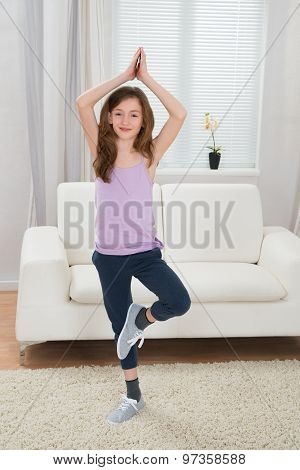 Girl Doing Yoga At Home
