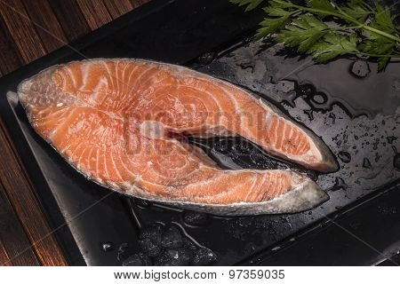a raw and freshness salmon on a black plate