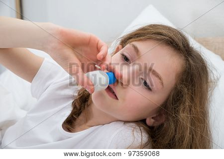 Girl Using Nasal Spray