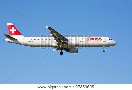 ZURICH - JULY 18: Airbus A-321 landing in Zurich airport after short haul flight on July 18, 2015 in Zurich, Switzerland. Zurich airport is home for Swiss Air and one of the european hubs.