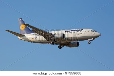 ZURICH - JULY 18: Boeing-737 Lufthansa landing in Zurich after short haul flight on July 18, 2015 in Zurich, Switzerland. Zurich airport is home for Swiss Air and one of biggest european hubs.