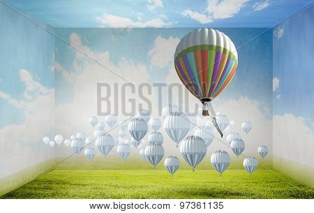 Businessman flying in search of ideas hanging on balloon