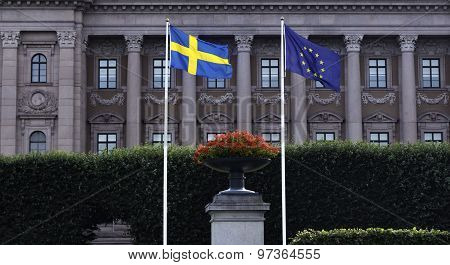 Swedish and EU Flag in front of the Swedish Parliament