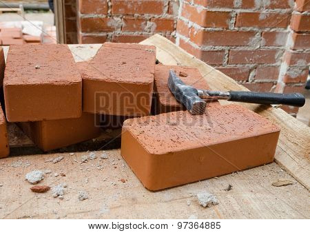 Mason bricklaying background with hammer
