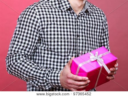 Close Up Man Holds Present In Hand