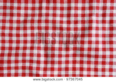 Texture of a red and white checkered picnic blanket.