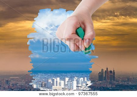 Hand Deletes Smog Urban Landscape By Eraser