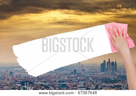 Hand Deletes Smog Sky Over City By Pink Rag