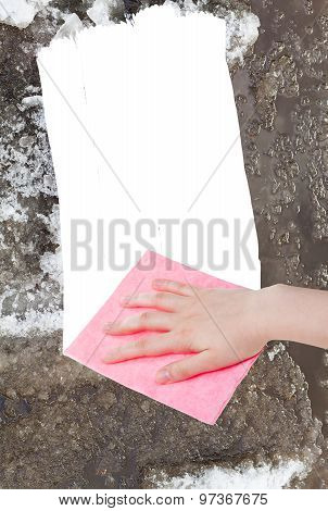 Hand Deletes Melting Snow By Pink Rag