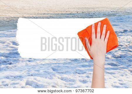 Hand Deletes Winter Snow By Orange Rag