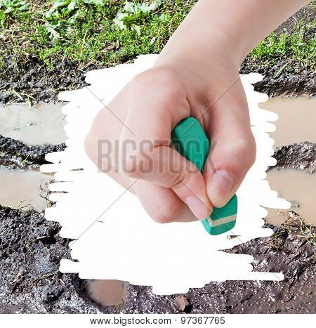 Hand Deletes Mud From Image Of Bad Country Road
