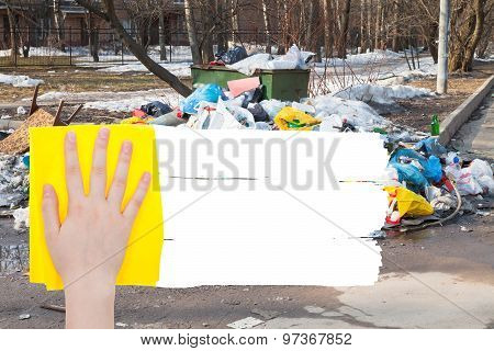 Hand Deletes Outdoor Trash By Yellow Rag