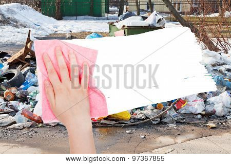 Hand Deletes Urban Dumpster By Pink Rag