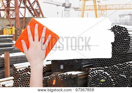 Hand Deletes Industrial Landscape By Orange Rag