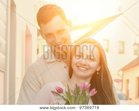 Couple meeting with flowers.