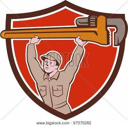 Plumber Lifting Monkey Wrench Crest Cartoon