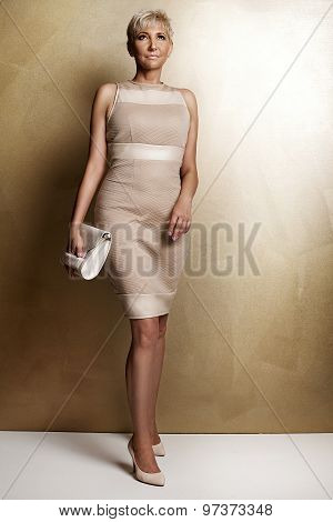 Elegant Blonde Woman In Fashionable Dress.