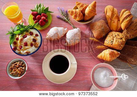 Coffee breakfast with orange juice croissant bread and strawberries