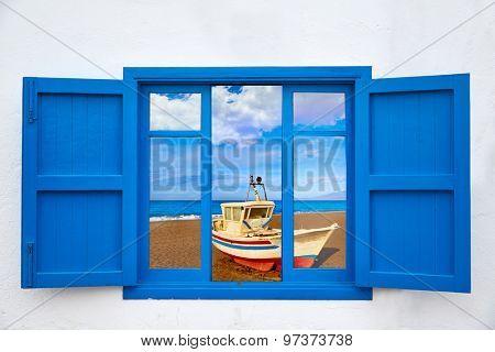 Almeria view from window of Cabo de Gata San Miguel beach photo mount