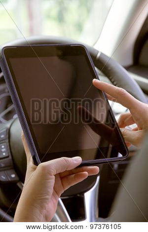 image of Woman Sitting in the Car and Using digital tablet