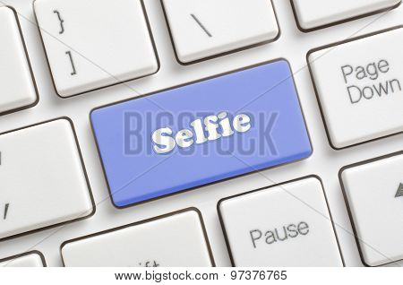 Blue selfie key on keyboard
