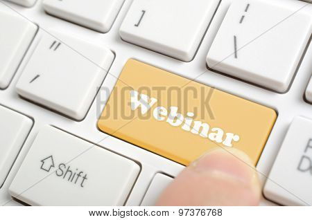 Pressing brown webinar key on keyboard