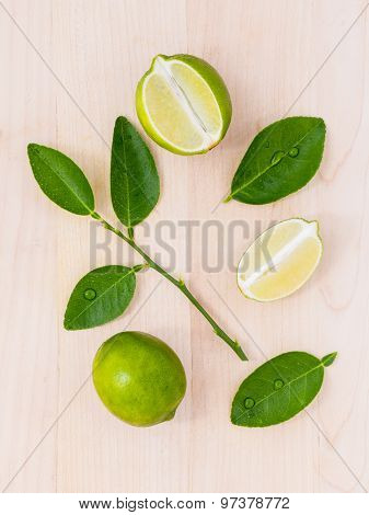 Fresh Lime And Lime Slice On Wooden Background With  Lime Leaf.