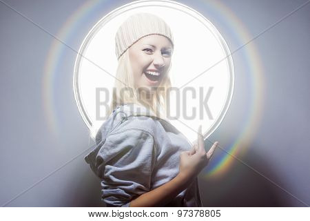 Young And Sexy Happy Blond Woman Posing In Studio Environment In Hoody And Warm Hat