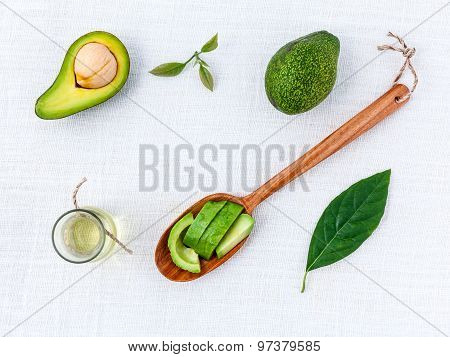 Avocado Oil On The White Table Background Clean And Healthy Concept.
