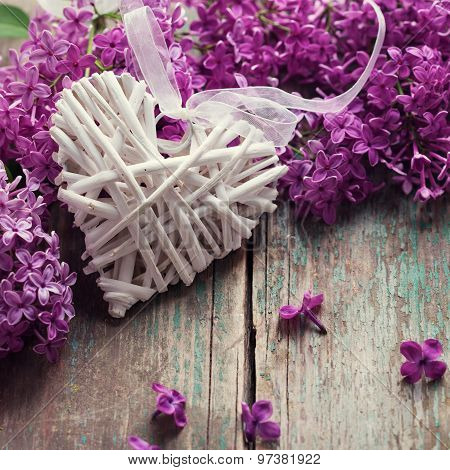 Background With Decorative Heart And Fresh Lilac Flowers