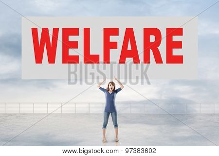 Woman holding card with text on it against the sky.