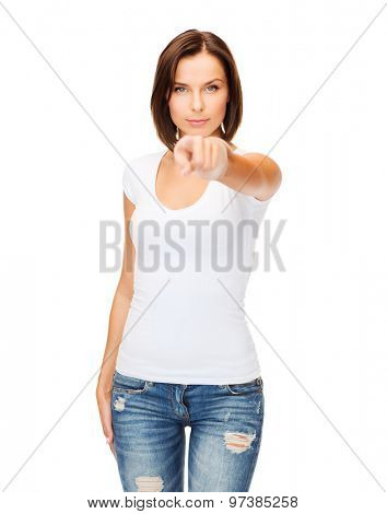 gestures and people concept - woman in blank white t-shirt pointing at you
