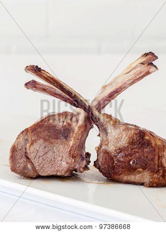 Roasted Lamb Chops On White Background.