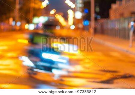 Motion blurred of motorcyclist on the city road at night. Transportation background