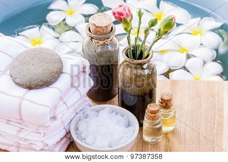 Spa And Wellness Treatment Setup On Wooden Panel.