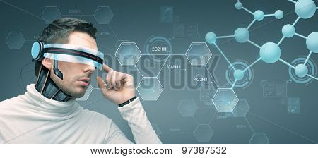 people, technology, future and progress - man with futuristic 3d glasses and microchip implant or sensors over gray background and molecules with chemical formulas