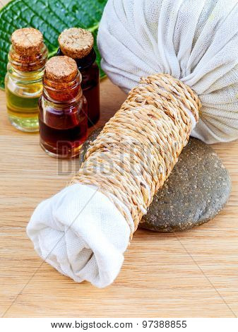 Natural Spa Ingredients . The Herbal Compress Ball And Massage Oil For Spa Treatment.