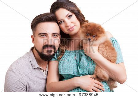 Gorgeous Smiling Couple With Dog In Hands