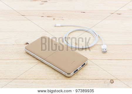Golden Powerbank And Usb Cable For Smartphone.