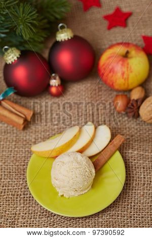 Scoop of apple ice cream with cinnamon for christmas