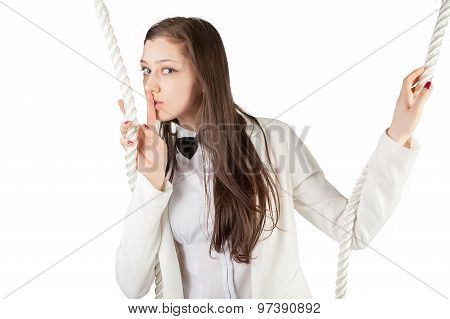 Young beautiful woman gesturing to silence
